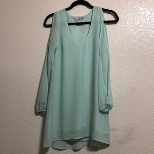 ice blue dress with open sleeve detail